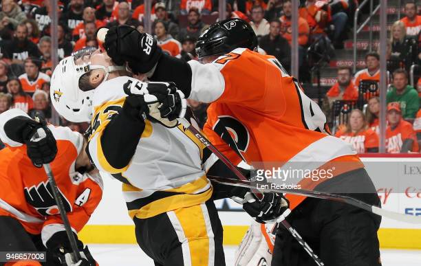 Andrew MacDonald of the Philadelphia Flyers shoves Conor Sheary of the Pittsburgh Penguins in the face in Game Three of the Eastern Conference First...
