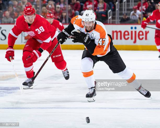 Andrew MacDonald of the Philadelphia Flyers skates after a loose puck in front of Anthony Mantha of the Detroit Red Wings during an NHL game at...