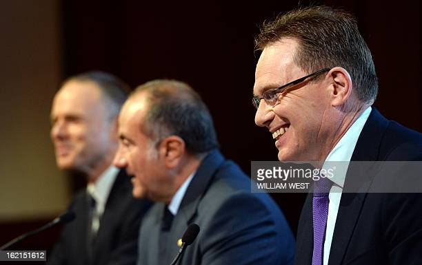 Andrew Mackenzie smiles as it is announced he will be replacing Marius Kloppers as BHP Billiton CEO as company chairman Jac Nasser speaks in Sydney...