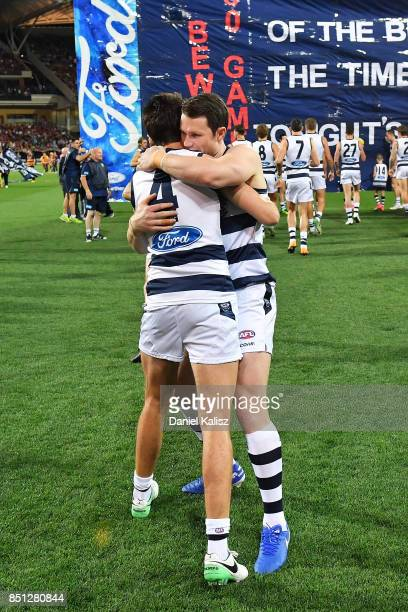 Andrew Mackie and Patrick Dangerfield of the Cats embrace during the First AFL Preliminary Final match between the Adelaide Crows and the Geelong...
