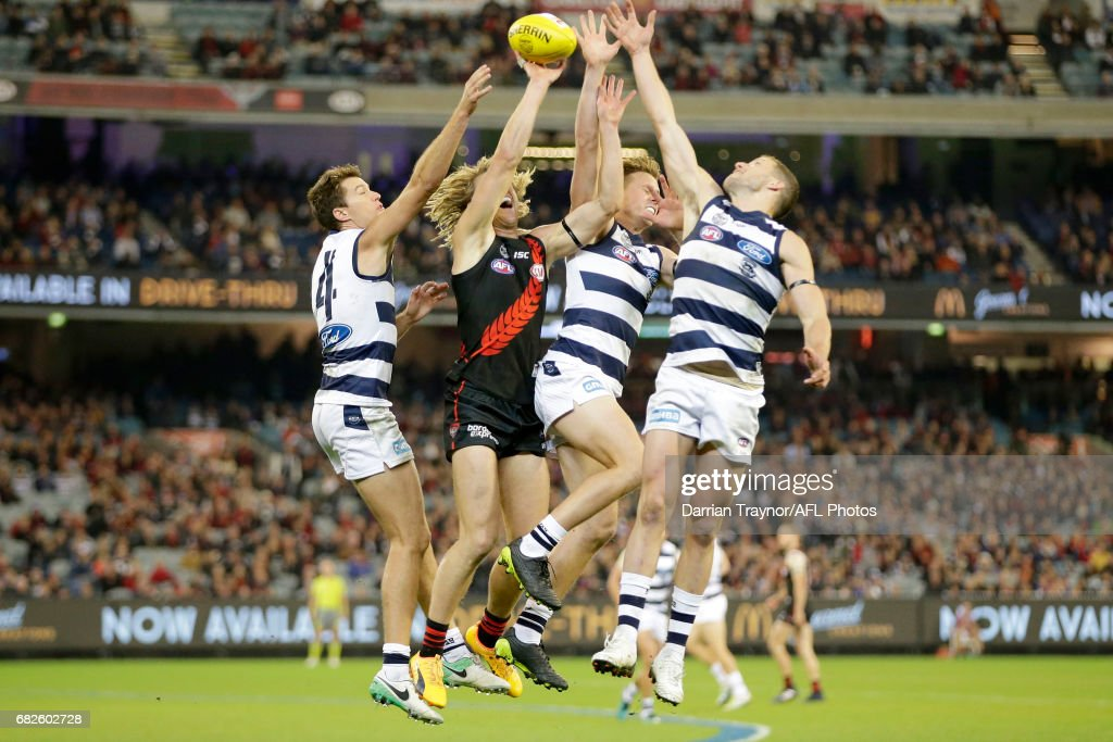 Andrew Mackie, Mitch Duncan and Sam Menegola of the Cats compete against Dyson Heppell of the Bombers during the round eight AFL match between the Essendon Bombers and the Geelong Cats at Melbourne Cricket Ground on May 13, 2017 in Melbourne, Australia.