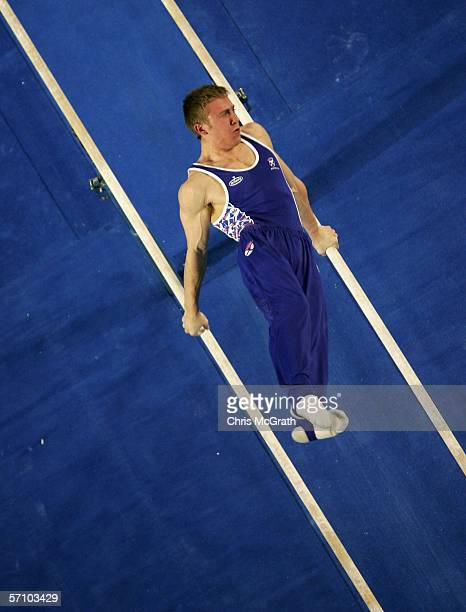 Andrew Mackie of Scotland competes on the parallel bars during the Men's Team competition in the artistic gymnastics at the Rod Laver Arena during...