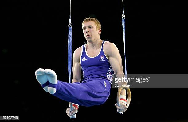 Andrew Mackie of Scotland competes on the rings during the Men's Team competition in the artistic gymnastics at the Rod Laver Arena during day one of...