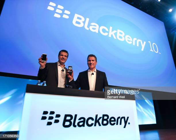 Andrew MacLeod Managing Director Canada and Brian Bidulka CFO RIM holds up the new phones during the global unveiling of BlackBerry 10 Waterloo¢Ê¨Ñ¢s...