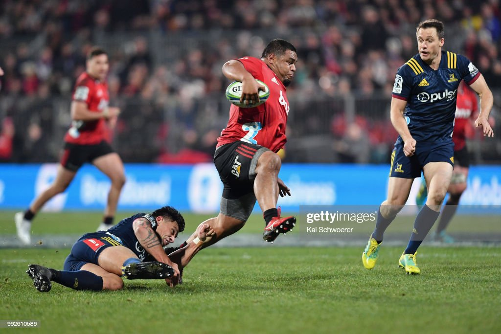 Andrew Makalio of the Crusaders is tackled by Rob Thompson of the Highlanders during the round 18 Super Rugby match between the Crusaders and the Highlanders at AMI Stadium on July 6, 2018 in Christchurch, New Zealand.