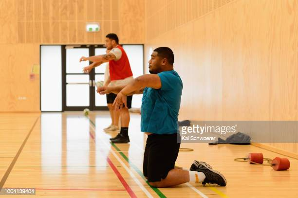 Head Coach Scott Robertson shoots a Basketball throw with a Rugby ball during a Crusaders Super Rugby training session at St Andrew's College on July...