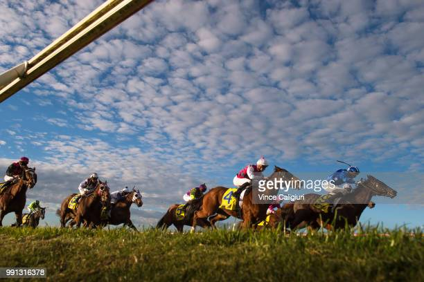 Andrew Mallyon riding Al Khabeer and Fred Kersley riding Kaptive Hero in Race 7 during Melbourne Racing at Sandown Hillside on July 4 2018 in...