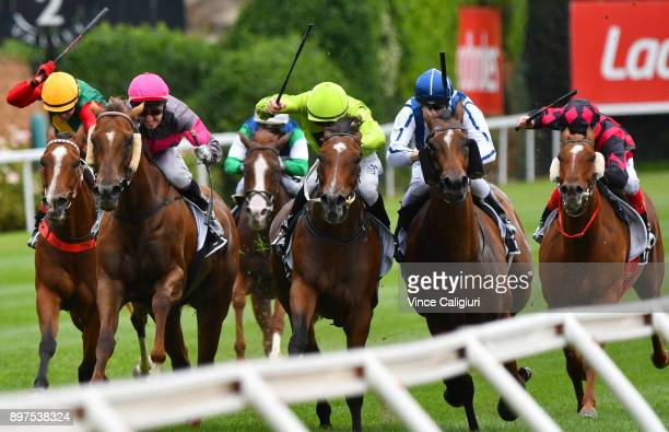 Andrew Mallyon riding Royal Applause defeats Beau Mertens riding Heavenly Descent during Melbourne Racing at Moonee Valley Racecourse on December 23...
