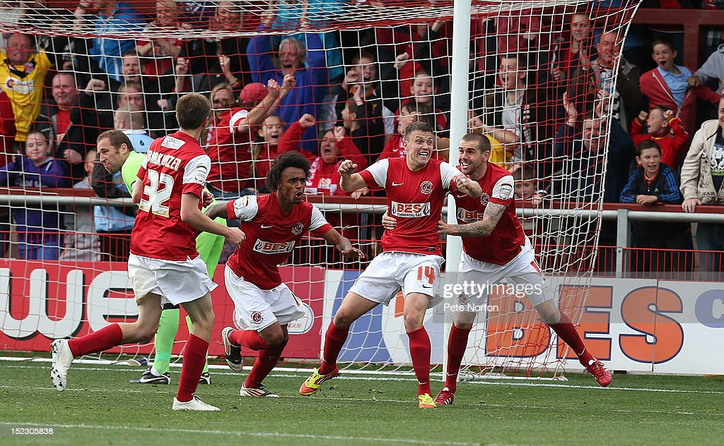 Andrew Mangan #14 of Fleetwood Town celebrates with team mates after scoring his sides goal during the npower League Two match between Fleetwood Town and Northampton Town at Highbury Stadium on September 15, 2012 in Fleetwood, England.