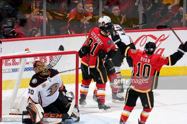 Andrew Mangiapane Garnet Hathaway and Derek Ryan of the Calgary Flames celebrate a goal against Ryan Miller of the Anaheim Ducks during an NHL game...