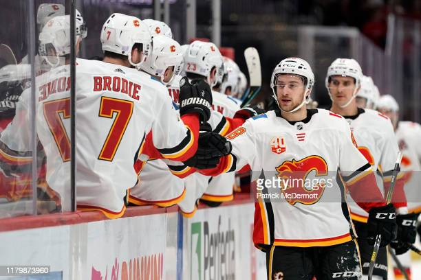 Andrew Mangiapane of the Calgary Flames celebrates after scoring a goal in the first period against the Washington Capitals at Capital One Arena on...
