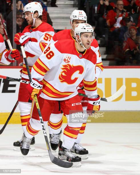 Andrew Mangiapane of the Calgary Flames celebrates after scoring a goal against the Anaheim Ducks on February 17 2020 at the Scotiabank Saddledome in...