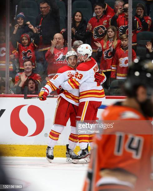 Andrew Mangiapane of the Calgary Flames celebrates his third goal against the Anaheim Ducks with Sean Monahan of the Calgary Flames during an NHL...