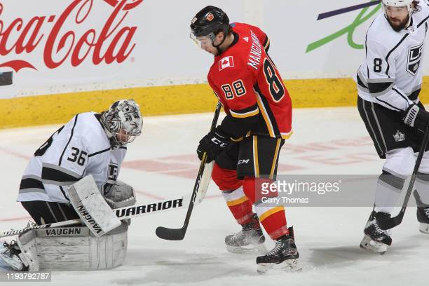 Andrew Mangiapane of the Calgary Flames gets a shot on net against Jack Campbell of the Los Angeles Kings at Scotiabank Saddledome on December 7,...