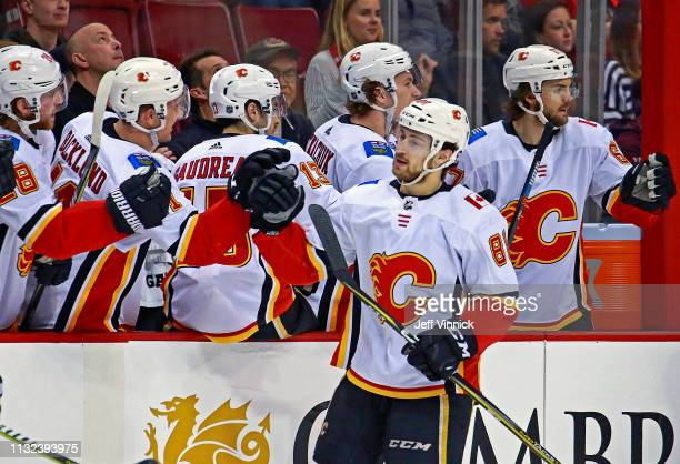 Andrew Mangiapane of the Calgary Flames is congratulated by teammates after scoring during their NHL game against the Vancouver Canucks at Rogers...