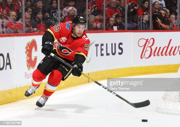 Andrew Mangiapane of the Calgary Flames plays the puck against the Los Angeles Kings at Scotiabank Saddledome on December 7, 2019 in Calgary,...