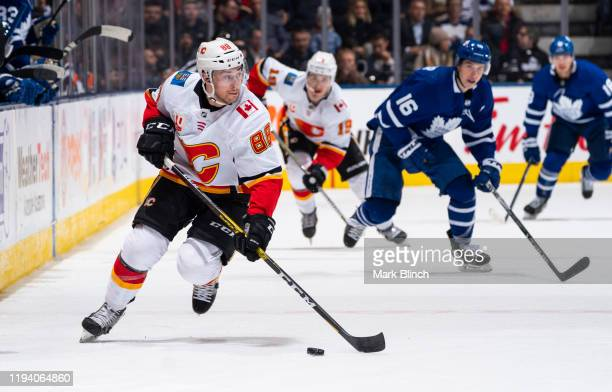 Andrew Mangiapane of the Calgary Flames plays the puck against the Toronto Maple Leafs during the second period at the Scotiabank Arena on January 16...
