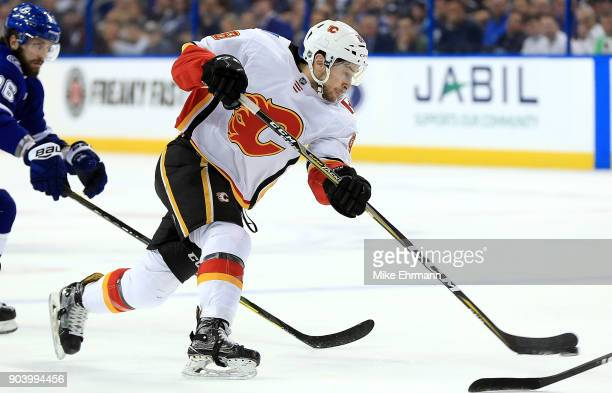 Andrew Mangiapane of the Calgary Flames shoots the puck during a game against the Tampa Bay Lightning at Amalie Arena on January 11 2018 in Tampa...