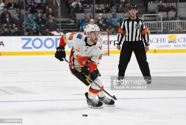 Andrew Mangiapane of the Calgary Flames skates with control of the puck against the San Jose Sharks during the third period of an NHL hockey game at...