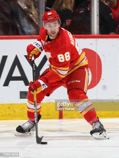 Andrew Mangiapane of the Calgary Flames skates with the puck against the Nashville Predators at Scotiabank Saddledome on February 6 2020 in Calgary...