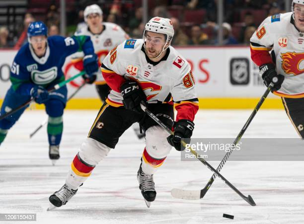 Andrew Mangiapane of the Calgary Flames skates with the puck in NHL action against the Vancouver Canucks at Rogers Arena on February 8 2020 in...