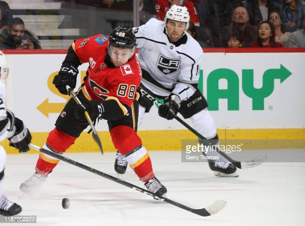 Andrew Mangiapane of the Calgary Flames takes a shot against the Los Angeles Kings at Scotiabank Saddledome on December 7, 2019 in Calgary, Alberta,...