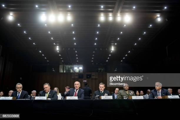 Andrew McCabe acting director of the Federal Bureau of Investigation from left Michael Pompeo director of the Central Intelligence Agency Dan Coats...