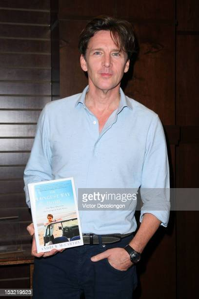 Andrew McCarthy holds a copy of his travel book The Longest Way Home at Barnes Noble bookstore at The Grove on October 1 2012 in Los Angeles...