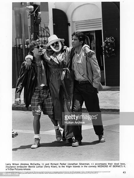 Andrew McCarthy with Jonathan Silverman carry their dead boss Terry Kiser in a scene from the TriStar Pictures movie Weekend at Bernie's II circa 1993