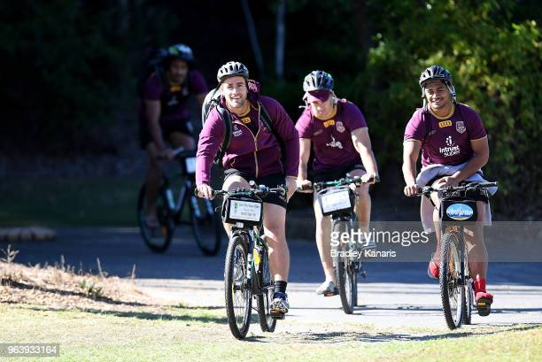 Andrew McCullough and team mates ride their bikes during a Queensland Maroons training session at Sanctuary Cove on May 31 2018 at the Gold Coast...