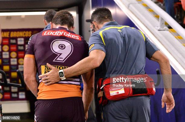 Andrew McCullough of the Broncos is taken from the field injured during the round seven NRL match between the Brisbane Broncos and the Melbourne...