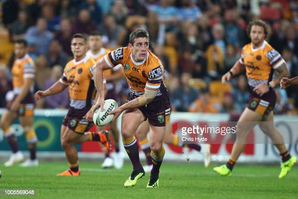 Andrew McCullough of the Broncos passes during the round 20 NRL match between the Brisbane Broncos and the Cronulla Sharks at Suncorp Stadium on July...