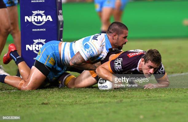 Andrew McCullough of the Broncos scores a try during the round four NRL match between the Brisbane Broncos and the Gold Coast Titans at Suncorp...