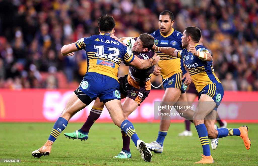 Andrew McCullough of the Broncos takes on the defence during the round 12 NRL match between the Brisbane Broncos and the Parramatta Eels at Suncorp Stadium on May 24, 2018 in Brisbane, Australia.