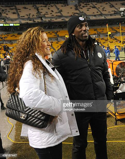 Andrew McCutchen an outfielder for the Major League Baseball Pittsburgh Pirates looks on from the sideline with his fiancee Maria Hanslovan before a...