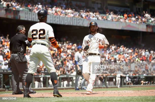 Andrew McCutchen and Brandon Crawford of the San Francisco Giants both score on a hit by Gorkys Hernandez of the San Francisco Giants in the first...