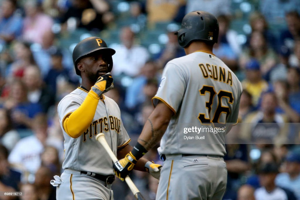 Andrew McCutchen #22 and Jose Osuna #36 of the Pittsburgh Pirates celebrate after McCutchen hit a home run in the third inning against the Milwaukee Brewers at Miller Park on June 20, 2017 in Milwaukee, Wisconsin.