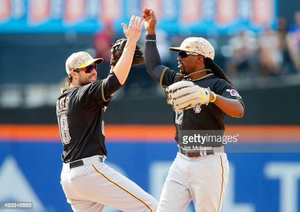 Andrew McCutchen and Neil Walker of the Pittsburgh Pirates celebrate after defeating the New York Mets at Citi Field on May 26 2014 in the Flushing...