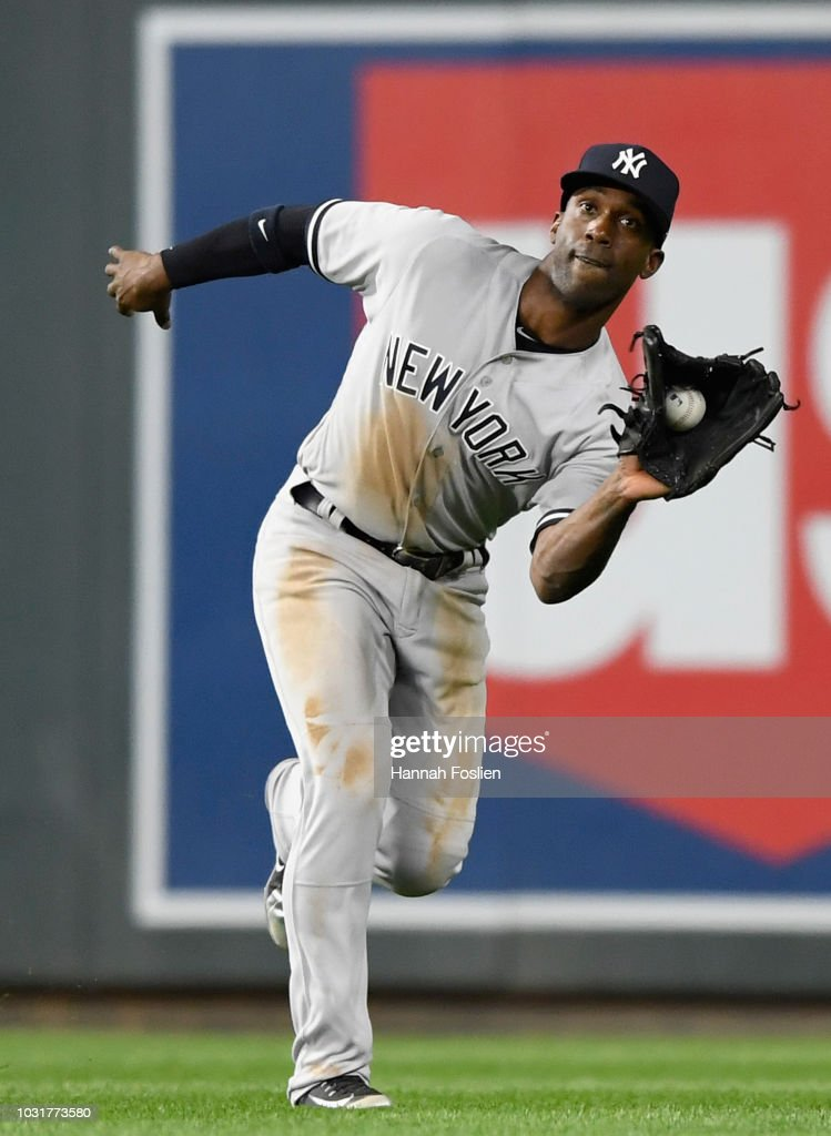 Andrew McCutchen #26 of the New York Yankees catches the ball hit by Willians Astudillo #64 of the Minnesota Twins in right field during the seventh inning of the game on September 11, 2018 at Target Field in Minneapolis, Minnesota. The Twins defeated the Yankees 10-5.