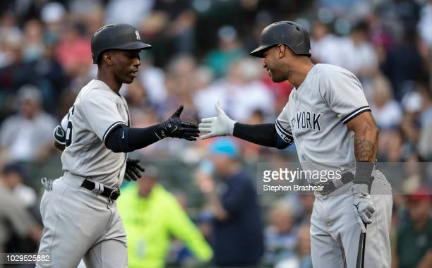 Andrew McCutchen of the New York Yankees is congratulated by Aaron Hicks of the New York Yankees after hitting lead off home run off of starting...