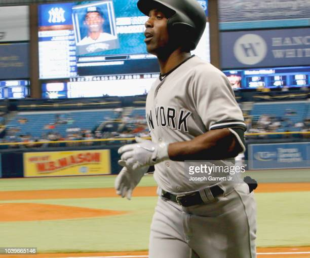 Andrew McCutchen of the New York Yankees jogs off the field after scoring the team's second run in the fifth inning of the game against the Tampa Bay...