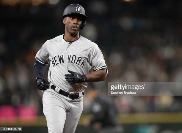 Andrew McCutchen of the New York Yankees rounds the bases after hitting a tworun home run off of starting pitcher James Paxton of the Seattle...