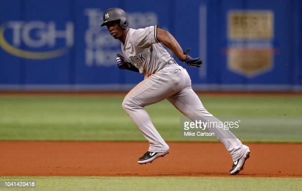 Andrew McCutchen of the New York Yankees takes off from first base in the first inning of a baseball game against the Tampa Bay Rays at Tropicana...