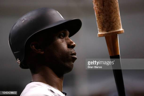 Andrew McCutchen of the New York Yankees warms up on deck during the sixth inning of a game against the Tampa Bay Rays on September 25 2018 at...