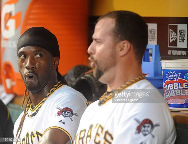 Andrew McCutchen of the Pittsburgh Pirates and Gaby Sanchez of the Pittsburgh Pirates react to a play against the San Francisco Giants at PNC Park on...