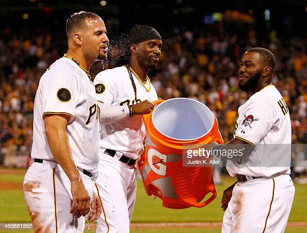 Andrew McCutchen of the Pittsburgh Pirates and Josh Harrison dump Gatorade on Gaby Sanchez after hitting a walk off sacrifice fly in the ninth inning...