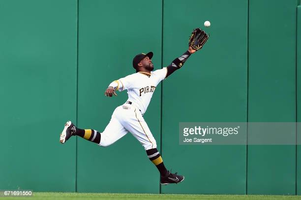 Andrew McCutchen of the Pittsburgh Pirates can't make a catch on a ball hit by Aaron Judge of the New York Yankees during the sixth inning at PNC...
