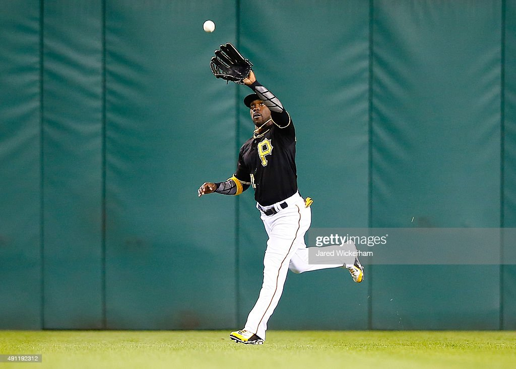 Andrew McCutchen #22 of the Pittsburgh Pirates catches a fly ball in center field in the 6th inning against the Cincinnati Reds during the game at PNC Park on October 3, 2015 in Pittsburgh, Pennsylvania.