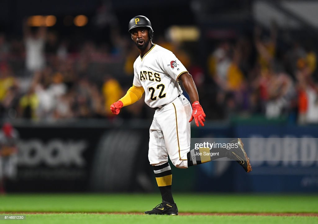 Andrew McCutchen #22 of the Pittsburgh Pirates celebrates a three run home run by Josh Bell #55 (not pictured) during the ninth inning against the St. Louis Cardinals at PNC Park on July 14, 2017 in Pittsburgh, Pennsylvania. Pittsburgh won the game 5-2.