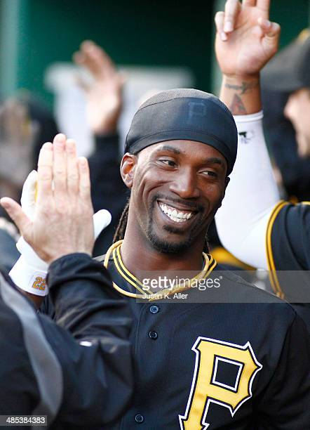 Andrew McCutchen of the Pittsburgh Pirates celebrates after hitting a tworun home run in the first inning against the Milwaukee Brewers during the...